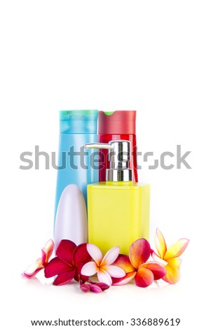Spa concept with the frangipani flowers with lotion bottles for spa treatment - stock photo
