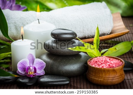 spa concept with zen basalt stones and salt - stock photo