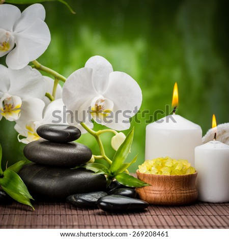 spa concept with zen basalt stones ,orchid and sea toning crystals