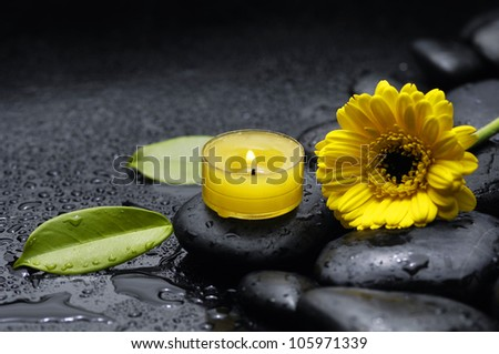 spa concept with zen stones with gerbera with candle on pebbles