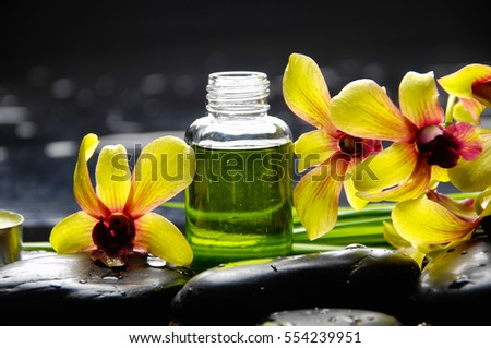 spa concept ??yellow orchid and long leaf ,oil