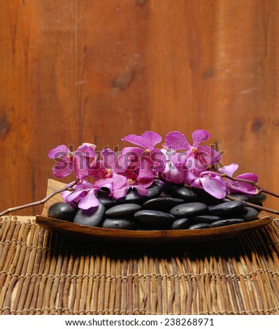 spa concept zen basalt stones and branch pink orchid,mat - stock photo