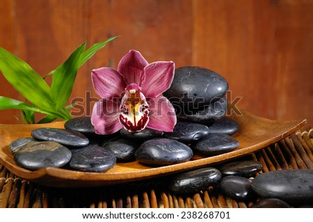 spa concept zen basalt stones and orchid,mat, bamboo  - stock photo