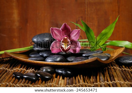 spa concept zen basalt stones and orchid,mat, bamboo leaf  - stock photo