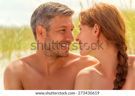 spa couple smiling eachother on dune - stock photo