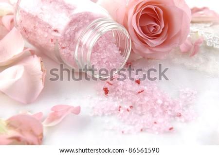Spa essentials (bath salt and rose petals) - stock photo