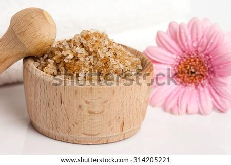 Spa essentials (bath salt in a bowl and flower) - stock photo