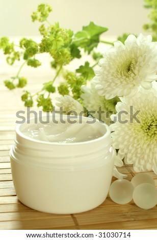 Spa essentials. Cream and flowers. - stock photo