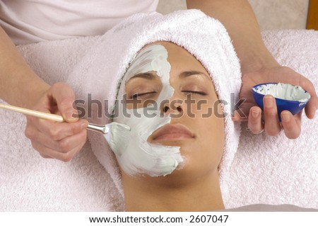 Spa Esthetician Applying Facial Masque - stock photo