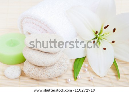 spa feeling (flower, towel and candle)