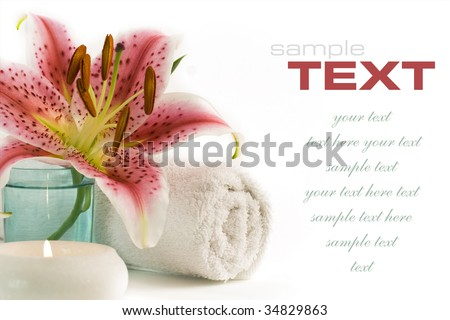 Spa feeling (flower, towel and candles reflected in water). With sample text - stock photo