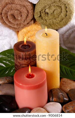 Spa feeling including candles and towels - stock photo