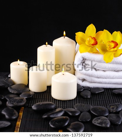 Spa feeling with branch yellow orchid ,towel ,candle pebbles