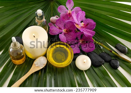 SPA flower and palm leaf - stock photo