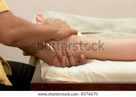 Spa foot massage close up - stock photo