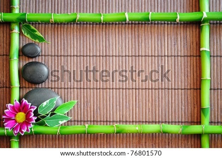 spa frame with zen stones and  flower - stock photo