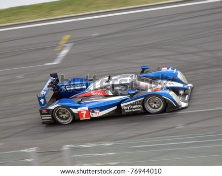 SPA-FRANCORCHAMPS, BELGIUM - MAY 7: British racing driver Anthony Davidson in the Peugeot 908 on his way to win the 1000 km of Spa-Francorchamps on May 7, 2011 in Francorchamps, Belgium. - stock photo