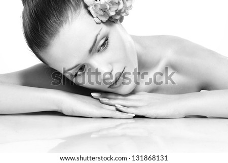Spa. Fresh clear healthy skin on the face of beautiful woman . Black and white - stock photo