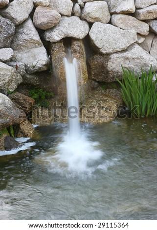 spa garden waterfalls, slow shutter - stock photo
