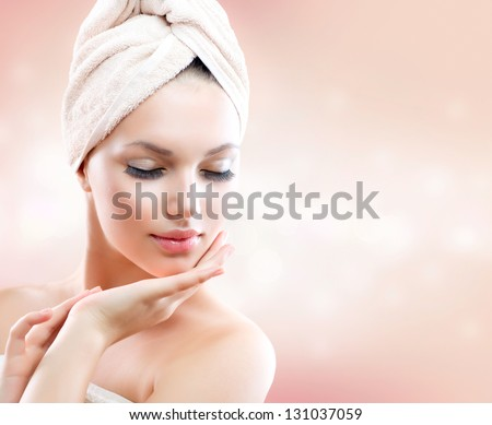 Spa Girl. Beautiful Young Woman After Bath Touching Her Face. Perfect Skin. Skincare. Young Skin - stock photo