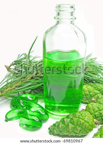 spa green oil bottle with fir natural coniferous extract - stock photo