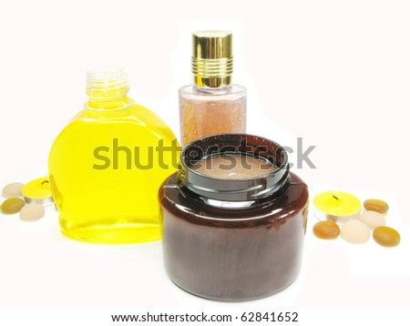 spa hair herbal shampoo candles among decorative pebble stones - stock photo