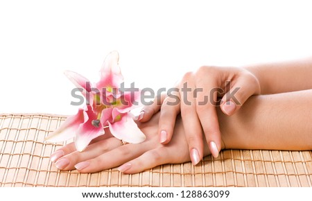 Spa hands over bamboo mat isolated