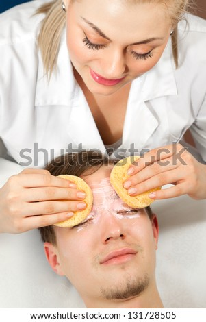 Spa. Handsome Man with a facial Mask on his Face - stock photo