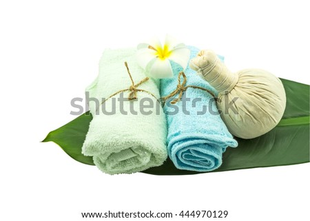 Spa herbal compressing ball,white frangipani flower(Plumeria spp,Apocynaceae,Pagoda tree flower,Temple tree )and blue fabric in green leaf isolate on white background.Saved with clipping path. - stock photo