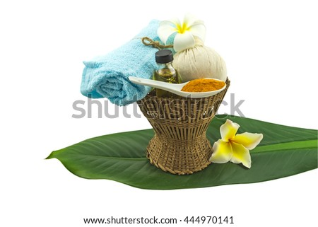 Spa herbal compressing ball,white frangipani flower,turmeric powder in white spoon massage oil and blue fabric in bamboo basket and green leaf tree on white background.Saved with clipping path - stock photo
