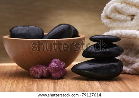 spa hot stone massage concept, towel, stones and potpourri - stock photo
