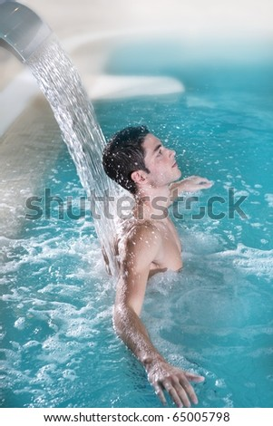 spa hydrotherapy man waterfall jet turquoise swimming pool water