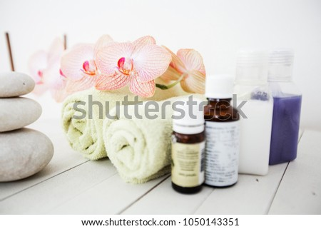 Spa Lifestyle, balance harmony zen stones, towels and flower orchids, aromatherapy