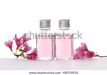 spa liquid and cherry flower - stock photo