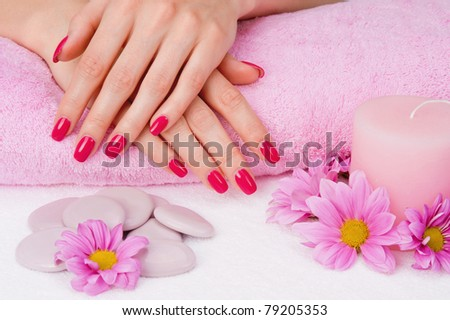 Spa manicure with pink flowers, stones and candle - stock photo