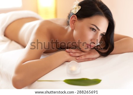 Spa Massage. Beautiful Brunette Gets Spa Treatment in Salon. - stock photo