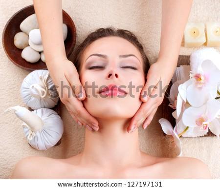 Spa Massage . Beauty Girl Getting Facial Massage - stock photo