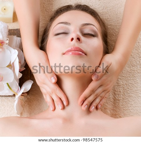 Spa Massage . Beauty Girl Getting Facial Massage - stock photo