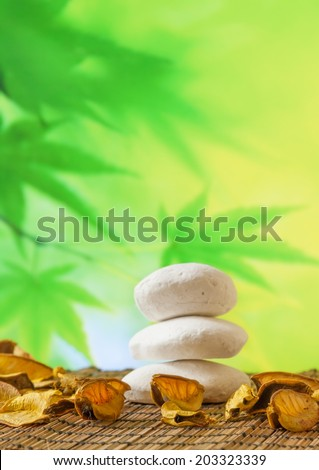 Spa massage border background with stone on bamboo table