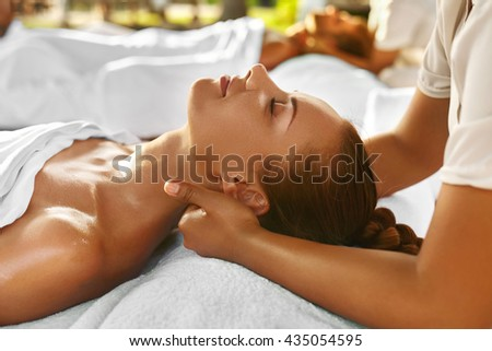 Spa Massage. Closeup Of Beautiful Healthy Happy Smiling Woman Getting Relaxing In Day Spa Salon Outdoors. Masseur Hand Massaging Neck With Aromatherapy Oil. Relax Body Care Beauty Treatment Concept - stock photo