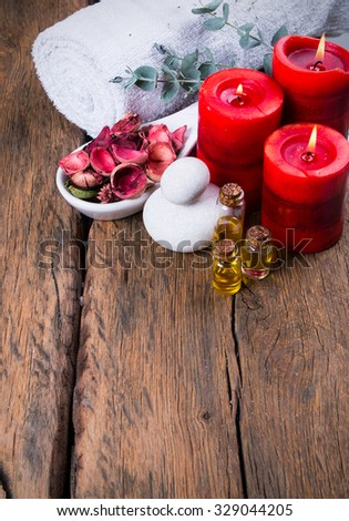 spa massage setting, nature product, oil on wooden background - stock photo