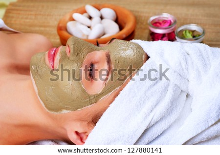 Spa Mud Mask. Woman in Spa Salon. Face Mask. Facial Clay Mask. Treatment - stock photo