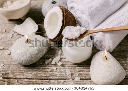 Spa. Natural coconut oil on the table - stock photo