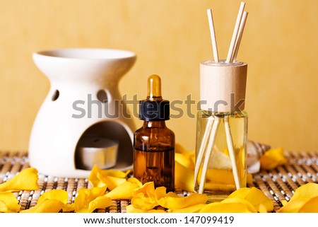 Spa object, aromatic oils and petals of roses - stock photo