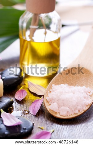 spa objects. stones and petals and salt. shallow dof - stock photo