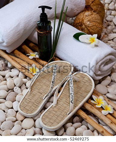 spa objects with tropica flowers - stock photo