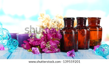 Spa oil and freesia on light background - stock photo