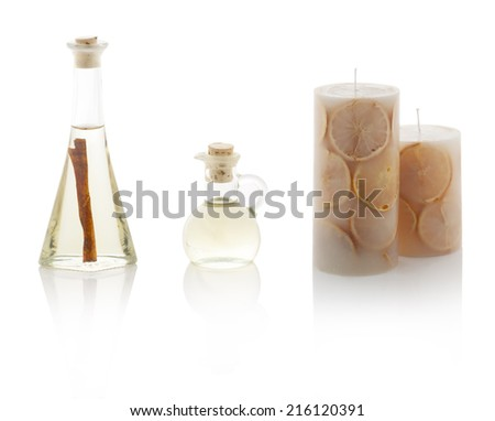 Spa oils in bottles and scented candles isolated on white background. With PS paths. - stock photo