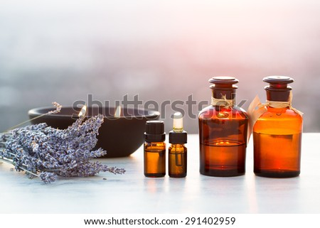 Spa oils in bottles with lavender - stock photo