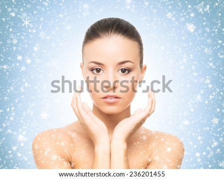 Spa portrait of young and beautiful woman over winter Christmas background  - stock photo